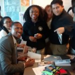 Sadiq signing books for the Honors Students at Digital Harbor